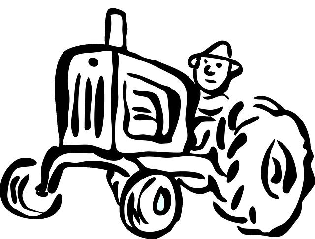 トラクターを動かす男性